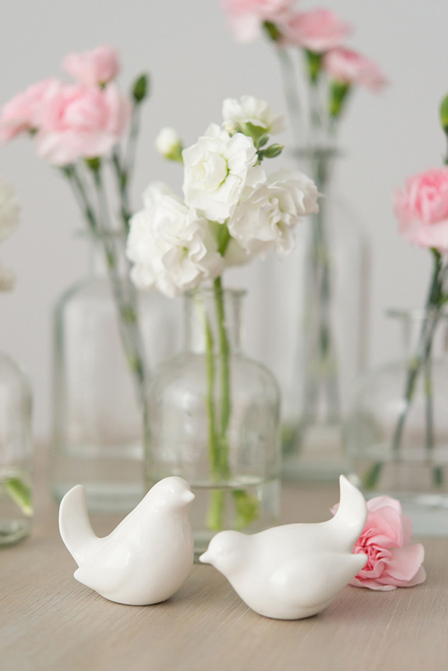Pink and White Carnations in Glass Bottles Wedding Decor Flowers Centrepiece | Confetti.co.uk