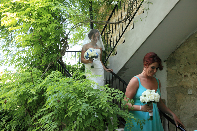 The bride walking down to the stairs to the ceremony
