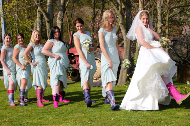 Bride and her bridesmaids in wellies