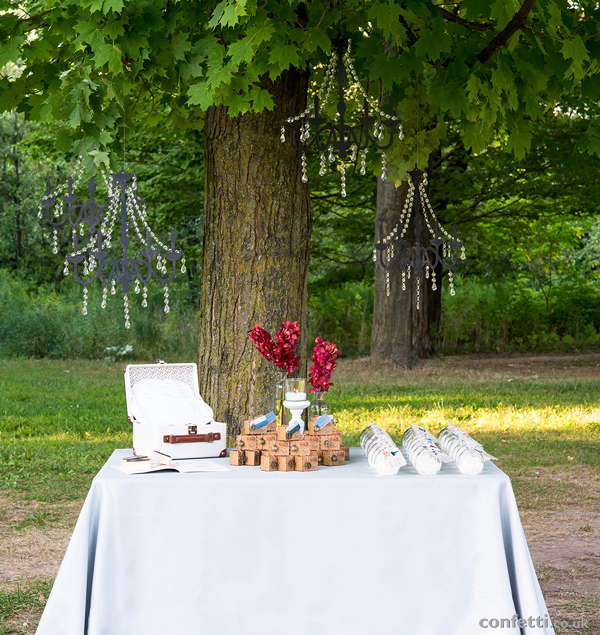 Wanderlust themed wedding table with black crystal chandeliers
