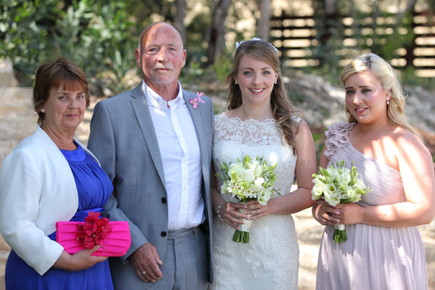 Bride with her parents and her bridesmaids