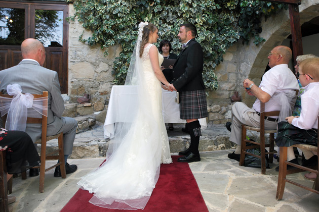 Bride and groom at the ceremony at the Vasilias Nikoklis Inn, Paphos