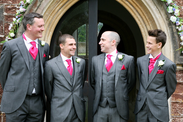 Groom and groomsmen in grey suits with hot pink cravat from Rossetti Brides| Confetti.co.uk