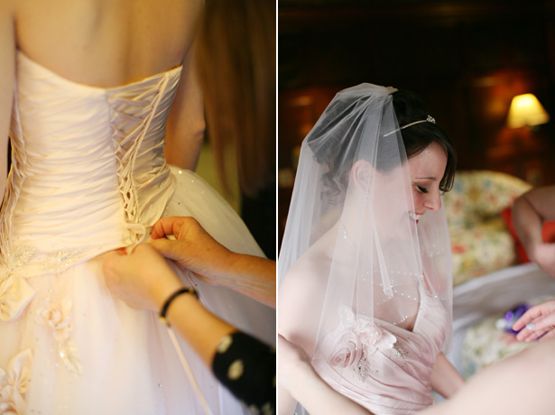 Lacing up the brides blush wedding gown | Confetti.co.uk