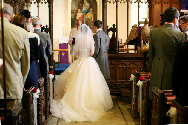 Bride and groom at the alter | Confetti.co.uk