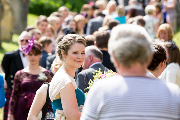 Bridesmaid in her teal Alfred Angelo dress | Confetti.co.uk