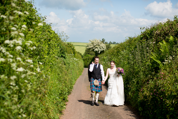 Bride and groom walking to the venue | Confetti.co.uk