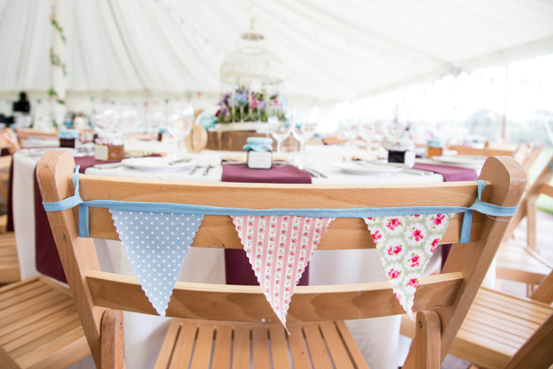 Rustic vintage bunting on chairs | Confetti.co.uk