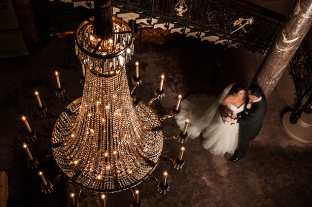 Bride and Groom with Crystal Chandelier - 10 Top Tips on Choosing Your Wedding Photographer