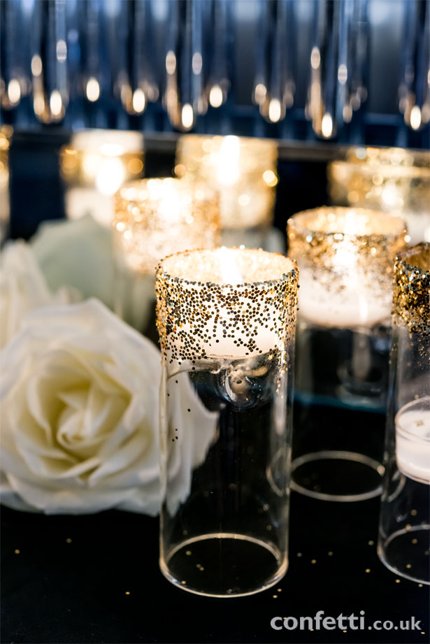 A bit of DIY adds an extra element of glamour to this art deco wedding reception from www.confetti.co.uk