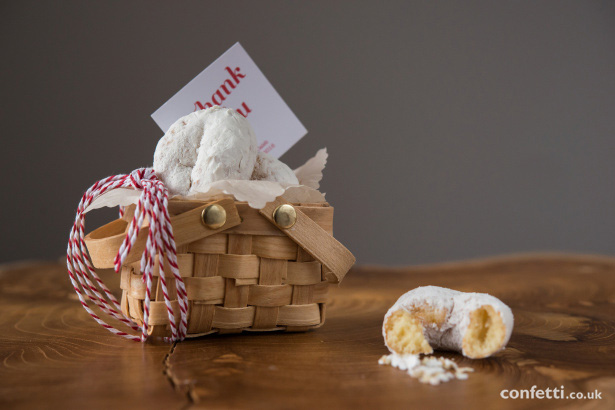 Tuck a few mini doughnuts into a small basket so your guests have a sweet treat to tuck into on the ride home from Confetti.co.uk