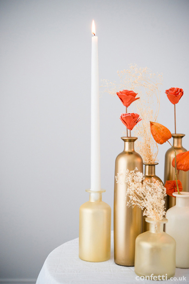 Tapers, faux flowers and painted glass bottles | Confetti.co.uk