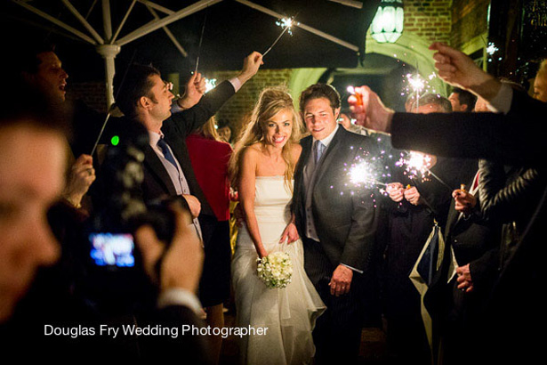 Styling Autumn Wedding | Real Wedding Autumn Wedding Entertainment Ideas | Wedding guests waving Sparklers as the bride and groom leave the venue |Image courtesy of Douglas Fry Wedding Photographer |Confetti.co.uk