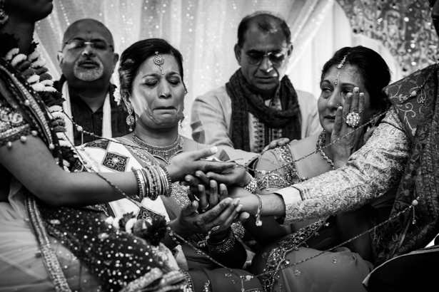 Emotional wedding guest during the ceremony | Traditional Hindu wedding customs | Confetti.co.uk