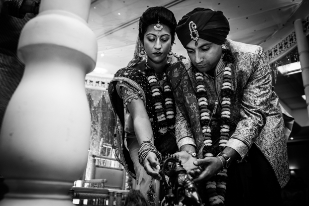 Bride and groom with the Lord Genesha during their ceremony | Traditional Hindu wedding customs | Confetti.co.uk