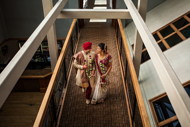The bride and groom in traditional Indian wedding outfits captured by Kabilan Raviraj| Bride and groom walking side my side | Confetti.co.uk