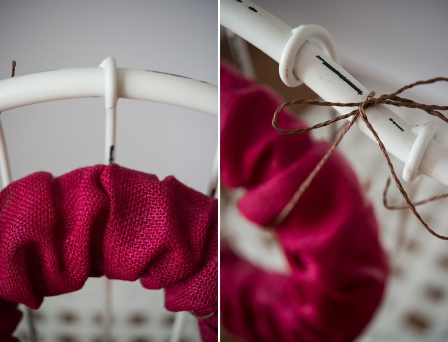 DIY Christmas Wreath - Cranberry red burlap wreath tied with twine to a wedding chair back | Confetti.co.uk