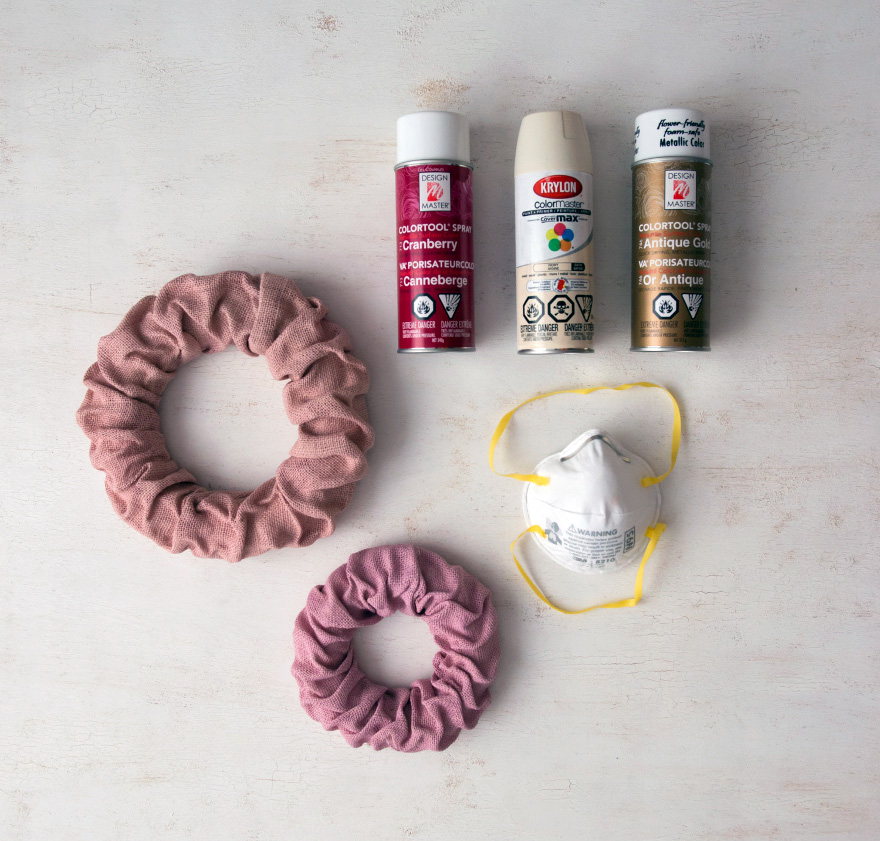 DIY Wreath Decor - Vintage pink burlap wreaths, mask, and colourful spray paint DIY supplies | Confetti.co.uk