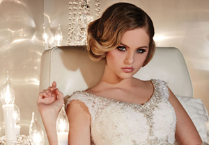 Glamourous bride and white appliqué wedding dress | Confetti.co.uk