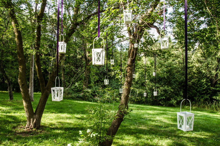 Lanterns Hanging from Tree Branches   Confetti.co.uk