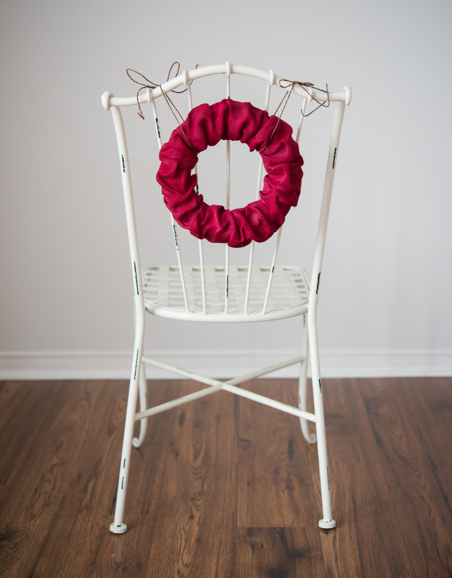 Red Wreath Chair Back - Burlap wreath as a chair back decoration | Confetti.co.uk