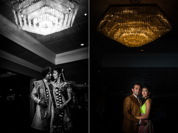 The bride and groom in traditional Indian wedding outfits  under a beautiful chandelier captured by Kabilan Ravira | Confetti.co.uk