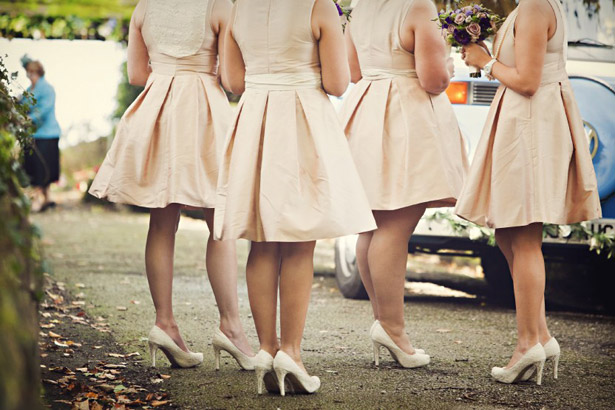 How to Choose Your Bridesmaids | Bridesmaids in vintage nude short dress with matching nude heels | Confetti.co.uk