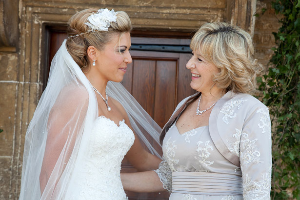 Mother of the Bride Wedding Duties | Image courtesy of Guyers House Hotel and Restaurant |Bride in her lace wedding dress with her mum in a grey dress | Confetti.co.uk