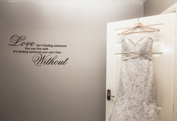 Love isn't finding someone you can live with, its finding someone you can't live without, quote on the wall | Lace , strapless, mermaid wedding dress| Becki and Rob's Real Wedding By Jenny Martin Photography | Confetti.co.uk