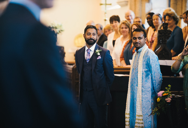 Groom in his blue Paul Smith suit along with his best man in a traditional blue sherwani, waiting for the bride at the altar | Francesca & Arun's Fusion Real Wedding | Confetti.co.uk