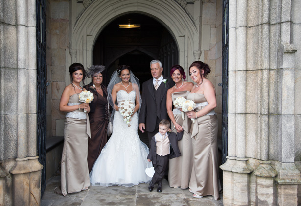 Bride with her bridal party outside the St. Michael and all Angels' church in Ashton | Becki and Rob's Real Wedding By Jenny Martin Photography | Confetti.co.uk