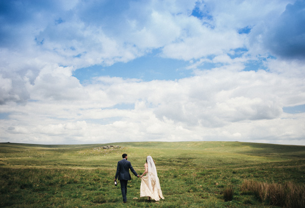 Official wedding shoot by Harrera Images | Bride and groom walking in the field | Francesca & Arun's Fusion Real Wedding | Confetti.co.uk