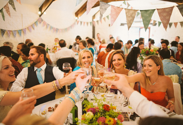 Wedding guest toasting the marriage | Francesca & Arun's Fusion Real Wedding | Confetti.co.uk