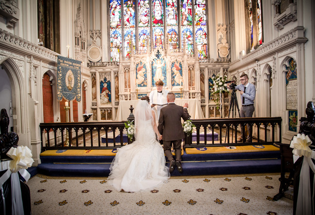 Bride and groom kneeling at the altar| Becki and Rob's Real Wedding By Jenny Martin Photography | Confetti.co.uk
