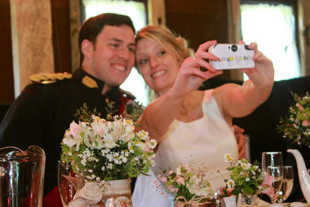 Wedding Worth Selfie | Bride and Groom taking a selfie with a digital camera | Confetti.co.uk
