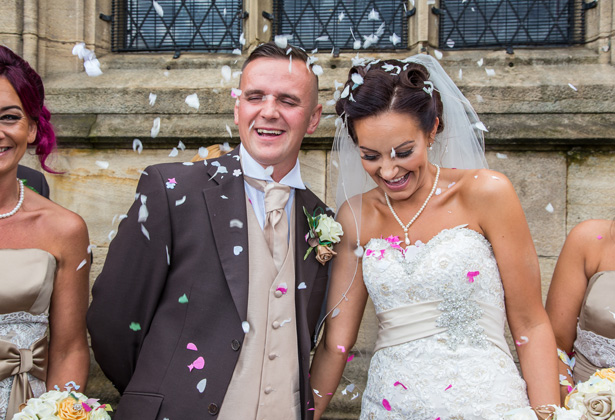 Guests throwing confetti over the bride and groom to celebrate the union | Becki and Rob's Real Wedding By Jenny Martin Photography | Confetti.co.uk
