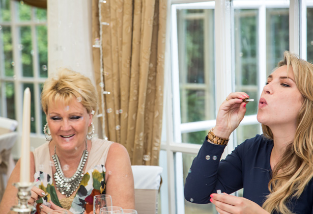 Wedding guests blowing bubbles at the wedding reception| Becki and Rob's Real Wedding By Jenny Martin Photography | Confetti.co.uk