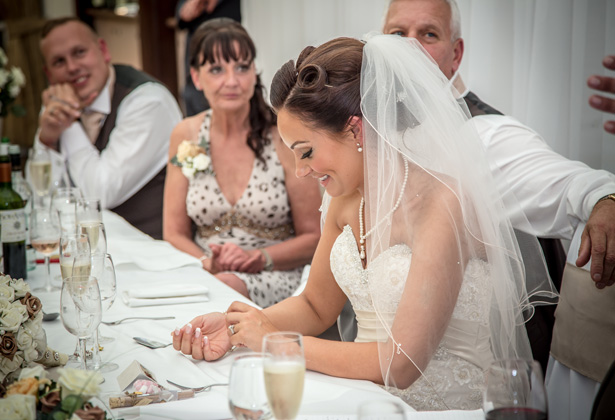 Bride at the top table enjoying the grooms speech | Becki and Rob's Real Wedding By Jenny Martin Photography | Confetti.co.uk