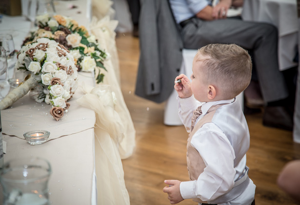 The newlyweds son blowing bubbles during the wedding speeches| Becki and Rob's Real Wedding By Jenny Martin Photography | Confetti.co.uk