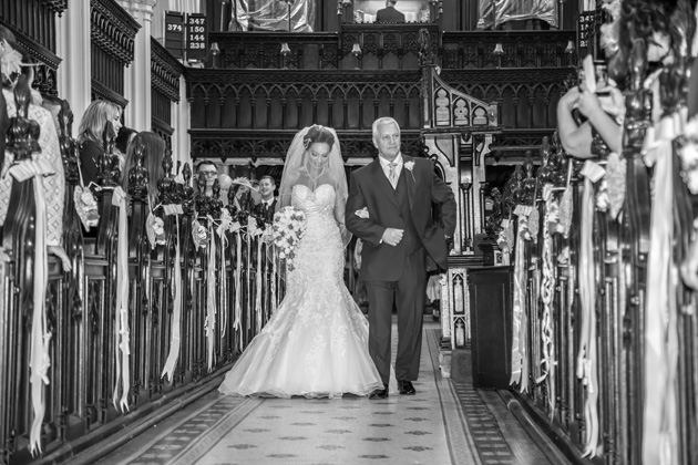 Bride walking down the aisle with her father | Becki and Rob's Real Wedding By Jenny Martin Photography | Confetti.co.uk