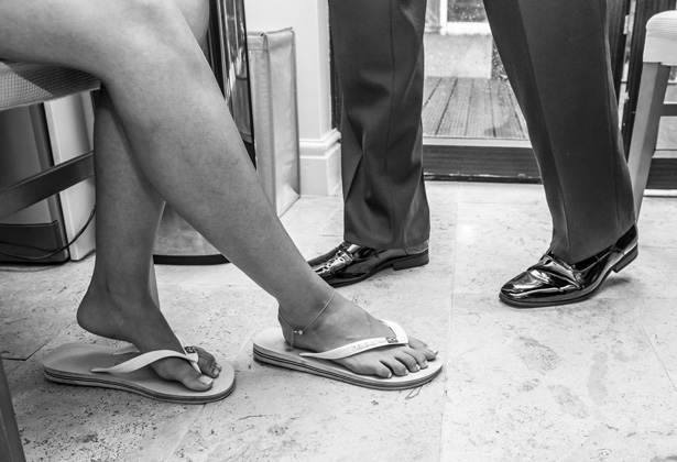 Bride wearing flip flops as she's getting ready for her wedding day | Becki and Rob's Real Wedding By Jenny Martin Photography | Confetti.co.uk