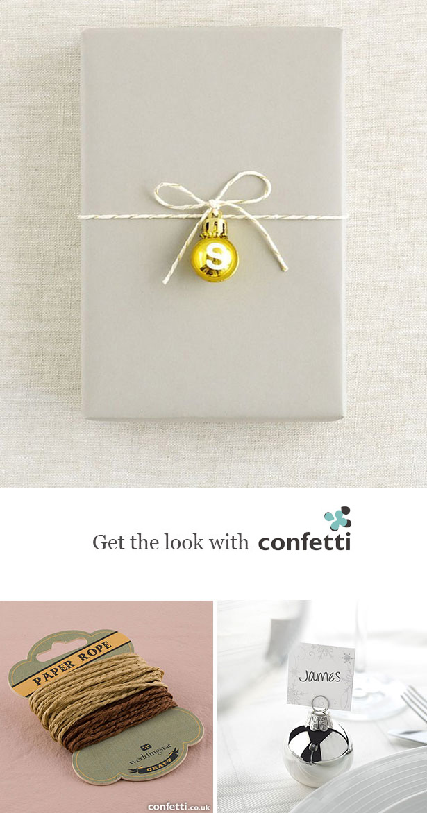 Creative gift wrapping |Gift decorated with a gold bauble and twine | Confetti.co.uk