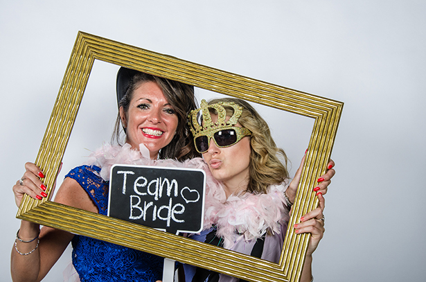 Wedding Worth Selfie \ Wedding Guests having fun with vinatge wedding props | Confetti.co.uk