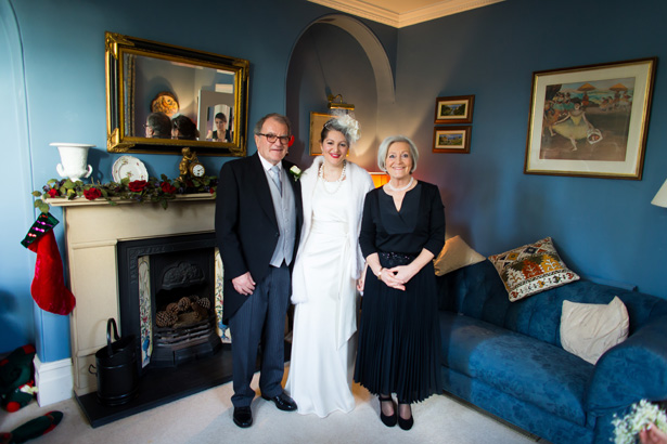 Bride with her parents | Abigail and Chris's Real Christmas Wedding | Confetti.co.uk