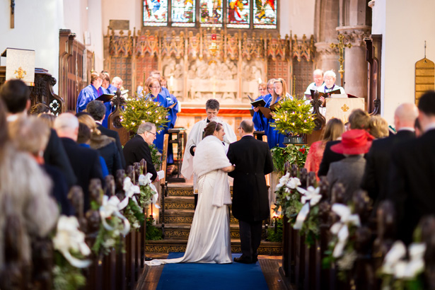 Bride and groom at the alter | Abigail and Chris's Real Christmas Wedding | Confetti.co.uk