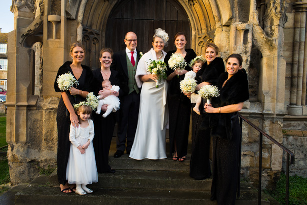 The newlyweds and bridesmaids outside the church | Abigail and Chris's Real Christmas Wedding | Confetti.co.uk