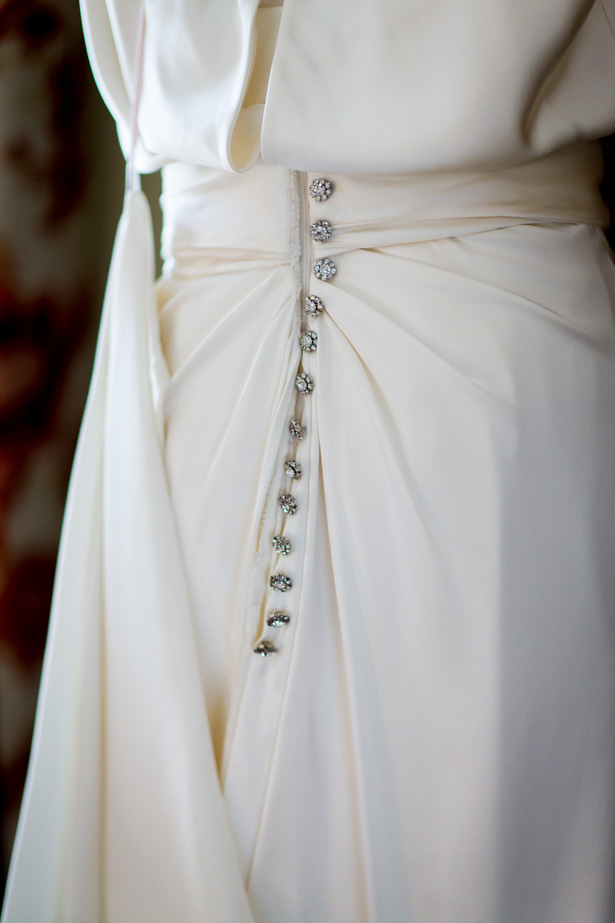 1920's inspired white wedding dress | Diamante detail buttons on the back of the wedding dress | Abigail and Chris's Real Christmas Wedding | Confetti.co.uk