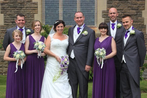 Bride and groom their bridesmaids and groomsmen outside the church after the ceremony | Purple themed wedding| Rhiannon & Michael's Real Wedding | Confetti.co.uk