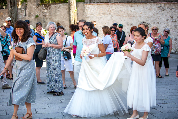 The bride and her bridesmaids walking through the town of Ravello, Italy | Leanne and Chris's Real Italian Wedding | Confetti.co.uk