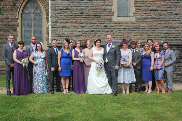 Bride and groom with their wedding guests| Purple themed wedding| Rhiannon & Michael's Real Wedding | Confetti.co.uk